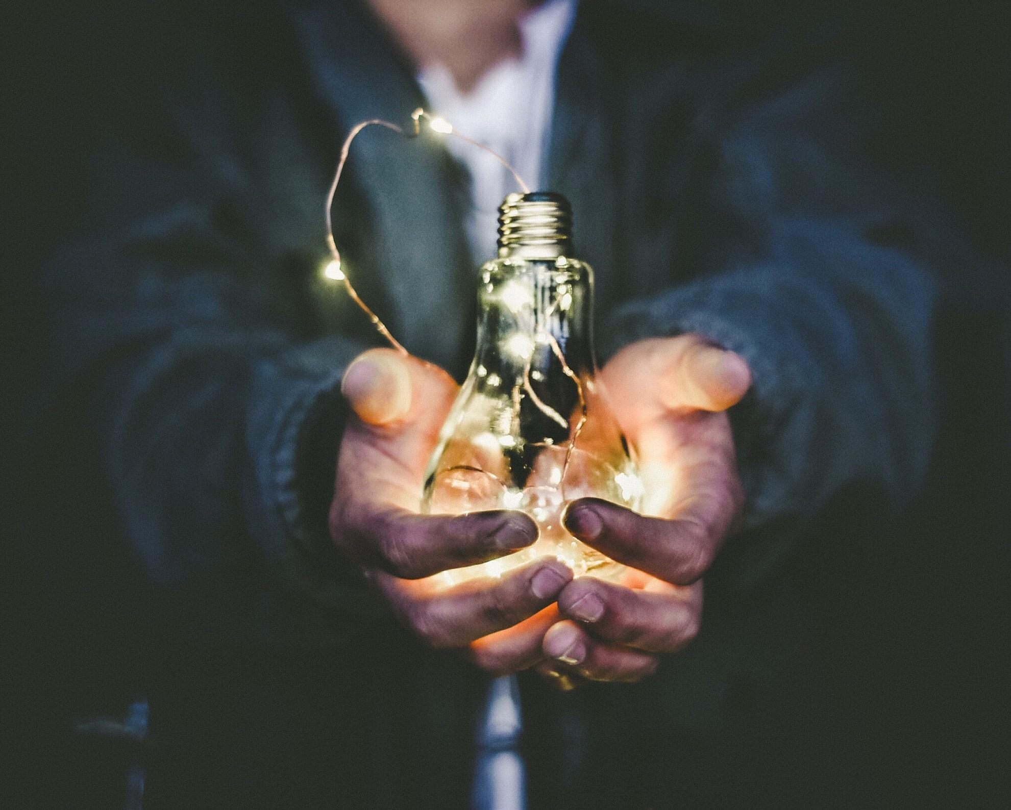 Innovate bulb in hand